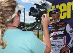 Day-two pro leader Jason Christie conducts an interview during weigh-in at Grand Lake.