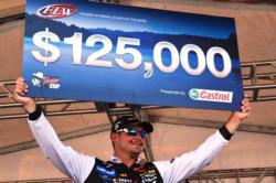 Jason Christie of Park Hill, Okla., proudly displays his first-place check after winning the FLW Tour event on Grand Lake.
