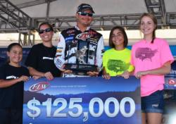 Jason Christie of Park Hill, Okla., shares the stage with his wife and daughters shortly after winning his second FLW Tour title of the season.