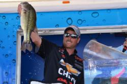 Chevy pro Bryan Thrift of Shelby, N.C., shows off his second-place catch in the finals.
