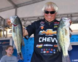 Chevy pro Jimmy Houston of Cookson, Okla., shows off his fourth-place catch on Grand Lake.