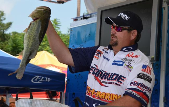 Second-place pro Dan Morehead holds up his biggest bass from day one on Lake Chickamauga.