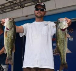 Second-place co-angler Shane Winchester holds up his two biggest bass from day one.