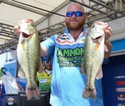 Co-angler Jason Johnson of Gainesville, Ga., takes the lead after weighing an impressive 19 pounds, 8 ounces on day one.