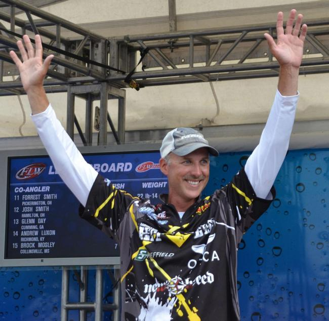 Andy Morgan celebrates after learning he won the 2013 Angler of the Year award.