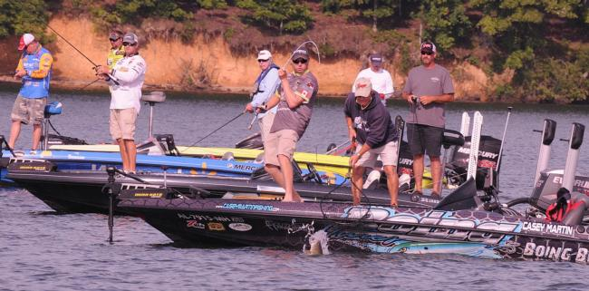 Casey Martin hauls in what he thinks is a giant bass..