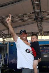 Daniel Buswell celebrates his victory with his son Skylar.