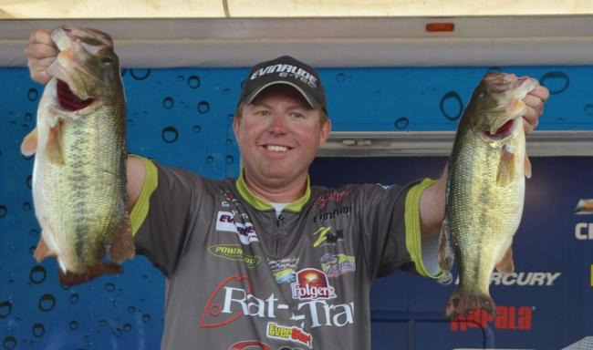 Pro winner Casey Martin holds up his two biggest bass from day four on Lake Chickamauga.