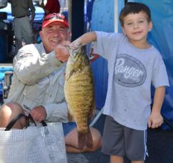 Gary Greenwood gets some assistance holding up his 5-pound, 2-ounce smallmouth bass.