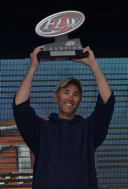 Co-angler champion Jim Hippensteel holds up his hardware.