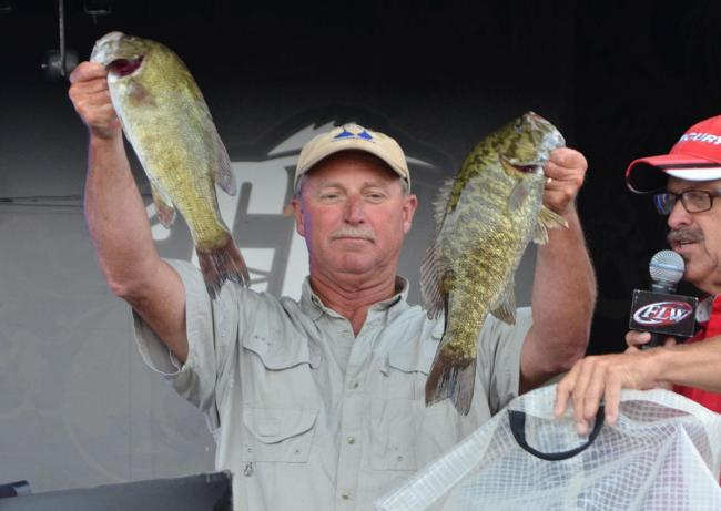 Rick Taylor retained second place after catching a 14-pound, 4-ounce limit Saturday.