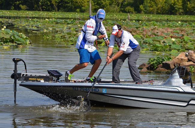 Adrian Avena fights a Red River largemouth to the boat.