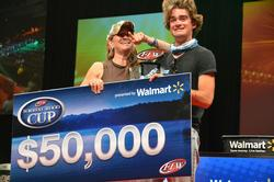Co-angler Theo Corcoran of Kansas City, Mo., basks in the afterglow of victory with his mom shortly after capturing the 2013 Forrest Wood Cup title.
