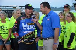Surrounded by friends and family, Ray Scheide talks with FLW tourney host Chris Jones shortly before day-three takeoff.