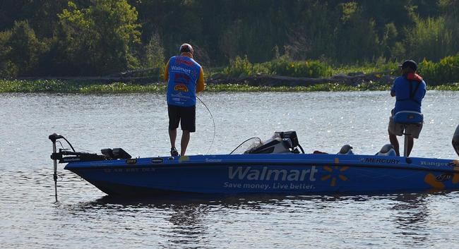 Mark Rose plays a crankbait fish to the boat Saturday morning.