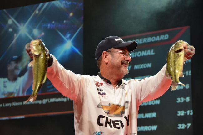 Chevy pro Larry Nixon holds up his catch. Nixon qualified for the finals of the 2013 Forrest Wood Cup in third place.