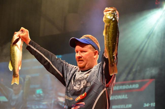 2013 BFL All-American winner Kerry Milner proudly displays his catch during the third day of Forrest Wood Cup competition.