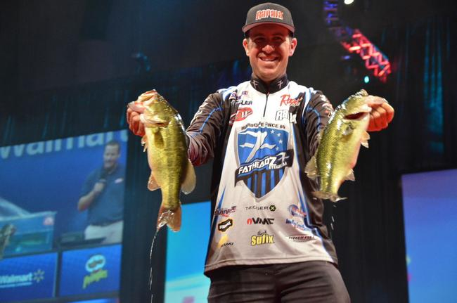 Jacob Wheeler shows off his catch en route to a second-place finish at the 2013 Forrest Wood Cup.