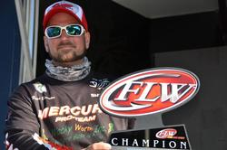 Ryan Bauman of Fleetwood, Pa., proudly displays his first-place trophy after capturing the co-angler title on the Chesapeake Bay.