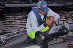 EverStart pro Adrian Avena checks his tackle before the start of takeoff.