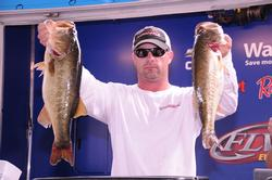 Wade Hudgens of Longview, Texas, is in second place with a five-bass limit weighing 23 pounds, 1 ounce.