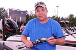 Rayburn winner Jason Wells shows off his winning combo: a Norman DD-22 on 12-pound fluorocarbon with a Lew