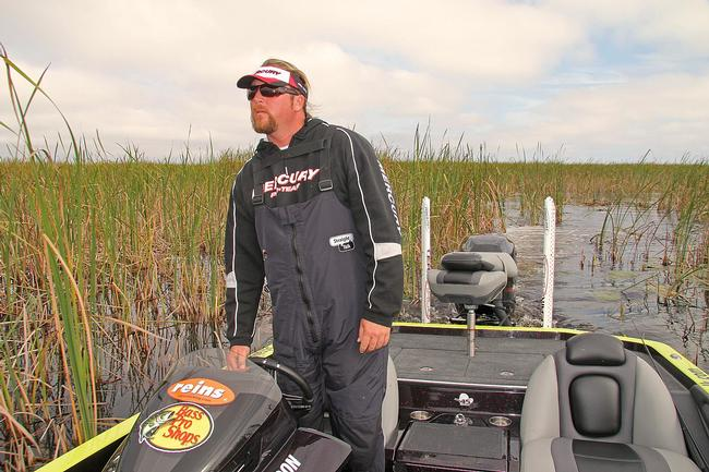FLW Tour pro JT Kenney carefully surveys the landscape while searching for prime fishing locations off the beaten path.