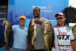 Castrol team pro David Dudley and his team proudly show off their catch during the inaugural Channing Crowder Charity Bass Tournament.