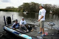 Keystone Light team pro Chad Grigsby prepares to depart the marina with his team during the inaugural Channing Crowder Charity Bass Tournament.