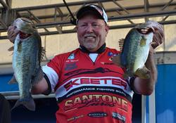 Third-place pro Matt Herren holds up his two biggest bass from day two on Lake Okeechobee.