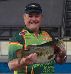 Leon Williams shows off his biggest bass from day three on Lake Okeechobee.