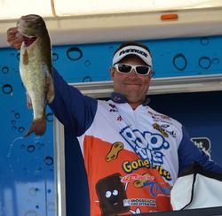 Second-place finisher Greg Bohannan holds up a good Lake Okeechobee largemouth.