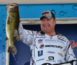 James Watson holds up the kicker that anchored his 20-pound, 15-ounce day-four stringer.