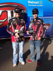 Lamar University teammates Quinton Evans and Colby Ogden proudly displays their first-place trophies after winning the Feb. 15. FLW College Fishing Southern Division event on Toledo Bend.