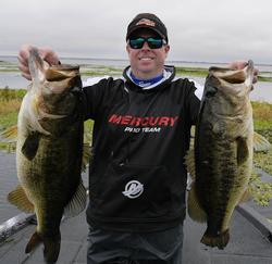 FLW Tour pro Tom Redington proudly displays his catch.