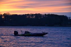 Boaters make their way across Lake Keowee at sunrise.