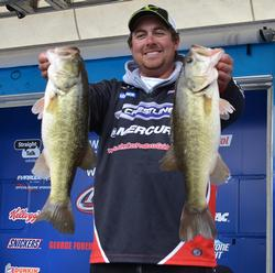 John Cox holds up two Lake Hartwell largemouths that anchored his 18-pound, 13-ounce stringer.