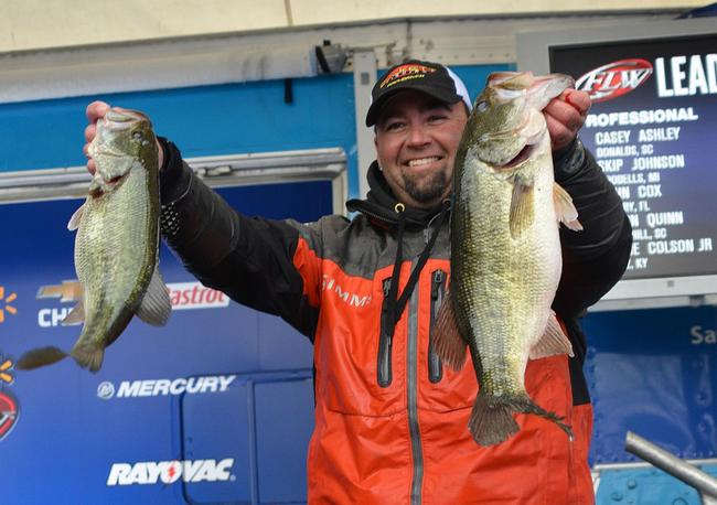 Jason Quinn holds up two Lake Hartwell largemouths that anchored his 18-pound, 9-ounce limit.