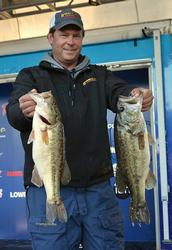 Co-angler David Redington smashed a 17-pound, 13-ounce limit Friday to take a sizeable lead with one day remaining.