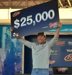 For winning the FLW Tour event on Lake Hartwell, co-angler David Redington earned $25,000.