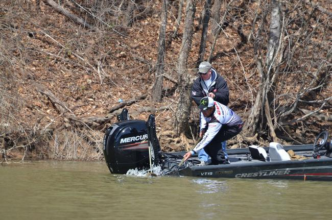 Co-angler Todd Lee battles his first keeper to the boat.