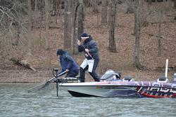 Randall Tharp wrestles fish number five into the boat on day one of the Walmart FLW Tour on Lake Hartwell.