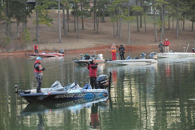 Casey Ashley starts his day amid a flotilla of spectators.
