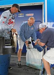 Day-two leader Russell Cecil loads his fish back into his bag after taking over the pro division.