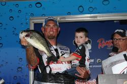 Joined by his son Ash, second-place pro Clark Reehm shows off one of his fish.