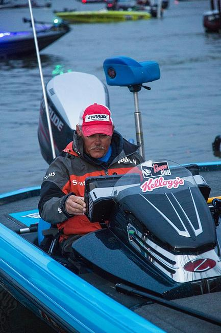 Local favorite Jim Tutt runs a systems check on his Lowrance electronics prior to takeoff.