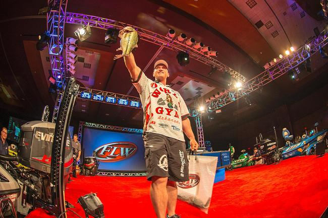 Travis Fox showing off his kicker largemouth for the hometown crowd.
