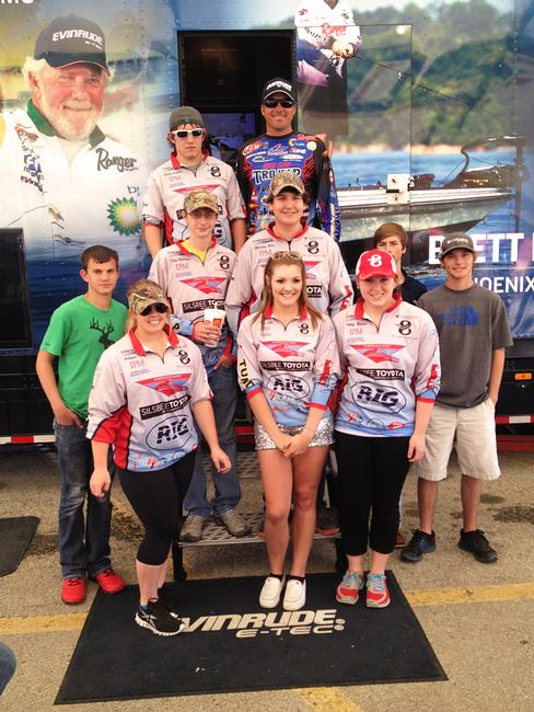 Walmart FLW Tour pro Scott Martin poses with student members of the Lumberton High School bass fishing team during the 2014 Sam Rayburn Tour event.