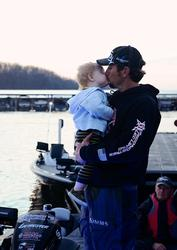 Stetson Blaylock and his son, Kei, share a good-luck kiss before takeoff at the Beaver Lake Walmart FLW Tour event.
