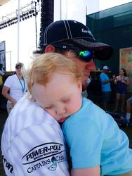 Stetson Blaylock holds his sleeping son, Kei right after final day weigh-in of the TTBC.